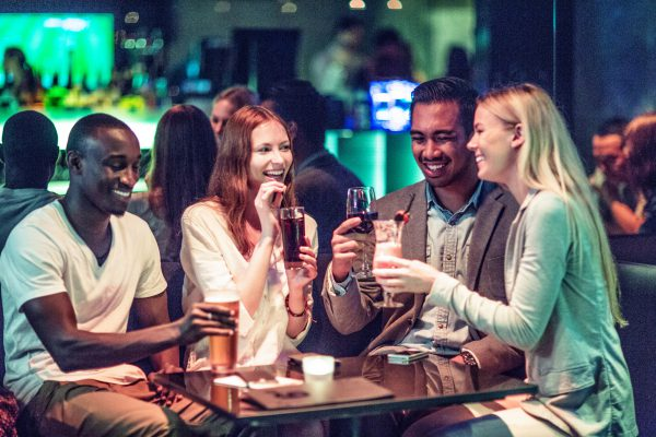 Four friends enjoying drinks
